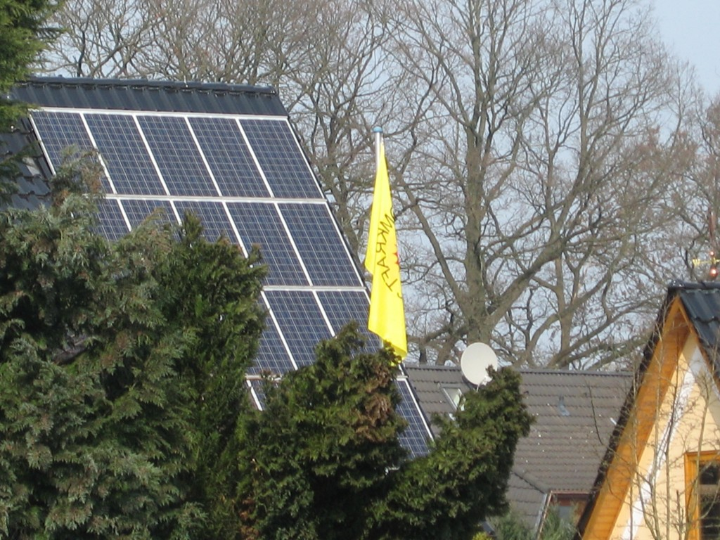 Protest flag in front of solar cells